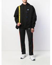 Pull a capuche et surpiqures noir ADER ERROR en coloris Black