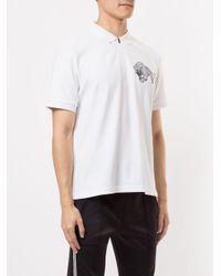 Polo à imprimé graphique Neil Barrett pour homme en coloris White