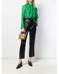 Pantaloni con pieghe di Nanushka in Black