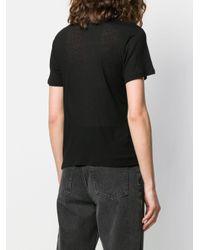 T-shirt à empiècement à étoiles brodées Saint Laurent en coloris Black