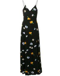 Vestido floral largo y acampanado Ganni de color Black