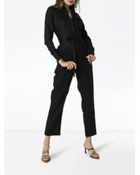 Mono Edna con cinturón Usisi de color Black