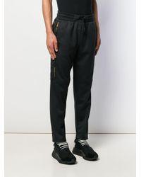 Pantalon de jogging à bandes logo Philipp Plein pour homme en coloris Black