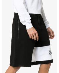 Short de sport oversize à logo Givenchy pour homme en coloris Black