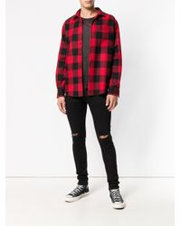 Distressed skinny jeans di Represent in Black da Uomo