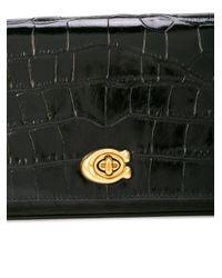 Bolso de mano Alexa Turnlock COACH de color Black