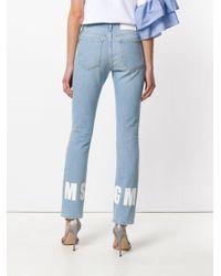 Jeans con logo posteriore di MSGM in Blue