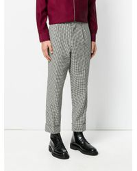 AMI Black Pleated Carrot Fit Trousers for men