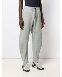 Pantalon de jogging à logo contrastant Nike pour homme en coloris Gray