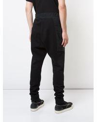 The Viridi-anne Black Oversized Pocket Tracksuit Bottoms for men