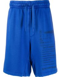 Moschino Blue Care Label Print Track Shorts for men
