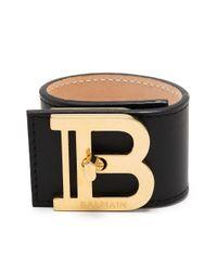 Bracelet manchette à plaque logo Balmain en coloris Black