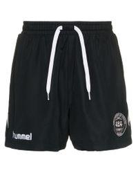 Shorts running x Hummel di 424 in Black da Uomo