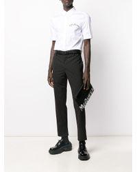 Clutch con stampa di Alexander McQueen in Black da Uomo