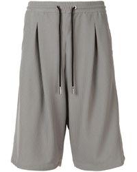 Short de jogging en résille Giorgio Armani pour homme en coloris Gray