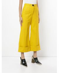 Awake Yellow Cropped Flared Trousers
