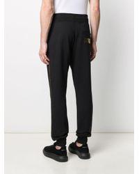 Pantaloni sportivi con stampa metallizzata di Versace Jeans in Black da Uomo