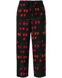 Pantalones con pétalos estampados Alexander McQueen de color Black