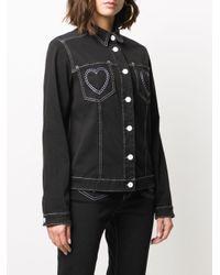 Veste en jean à cœurs brodés Love Moschino en coloris Black