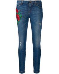 Jeans skinny con ricamo di Dolce & Gabbana in Blue