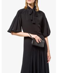 Mini sac à main Saffiano à plaque logo Prada en coloris Black