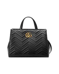 04a86557838 Gucci Gg Marmont Matelassé Top Handle Bag in Black - Lyst
