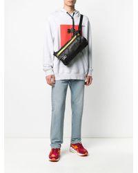 Sac porté épaule zippé à détail de slogan Eastpak pour homme en coloris Black