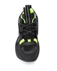 Sneakers con pannelli a contrasto di Ganni in Black