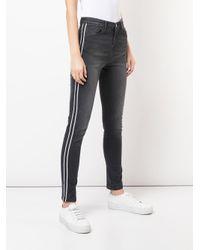 Jeans con banda laterale di Nicole Miller in Multicolor