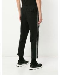メンズ PUMA サイドロゴ パンツ Black