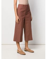 Pantaloni crop con logo GG di Gucci in Brown