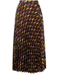 Jupe mi-longue plissée Sandro en coloris Black