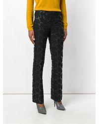 Pantaloni con fiori trapuntati di Marni in Black