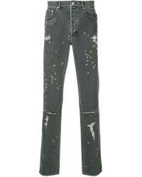 Vaqueros pitillo con efecto desgastado Givenchy de hombre de color Gray