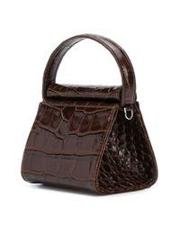Mini sac à main à effet peau de crocodile GU_DE en coloris Brown
