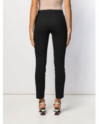 Pantalones slim lisos Incotex de color Black
