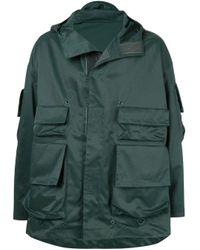 Abrigo estilo militar Undercover de hombre de color Green