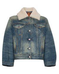 Veste en jean à imprimé graphique au dos Gucci en coloris Blue