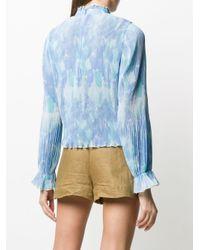 Blusa plisada con motivo floral Ganni de color Blue