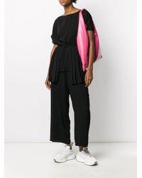Pantaloni crop a gamba ampia di MM6 by Maison Martin Margiela in Black