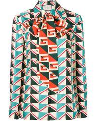 Blusa con estampado geométrico y lazo en el cuello Gucci de color Multicolor