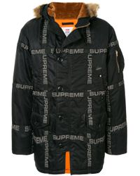 Piumino con stampa di Supreme in Black da Uomo