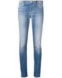 Jean skinny à taille basse Emporio Armani en coloris Blue