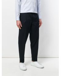 Corneliani Blue Tapered Trousers for men