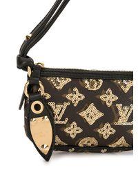Sac à main à motif monogrammé Louis Vuitton en coloris Brown