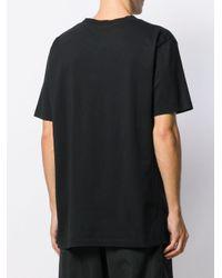 T-shirt oversize con logo di Marcelo Burlon in Black da Uomo