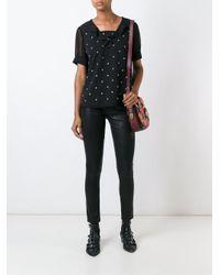 COACH Black Star Stud Embellished Top
