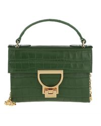 Mignon Croco Shiny Soft Crossbody Bag Leaf Coccinelle en coloris Green