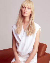 L'Agence - White Snap Back Blouse - Lyst