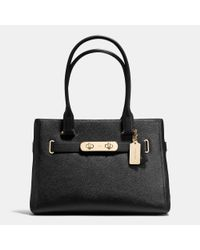 COACH | Black Swagger Pebbled-Leather Tote | Lyst